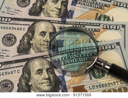 Magnifying Glass On A Background Of Money.