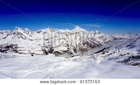 Snow Alps Mountains View And Blue Sky