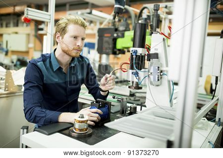 Young Man In Electronics Workshop