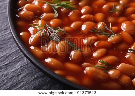 White Beans In Tomato In A Black Bowl Close-up Horizontal