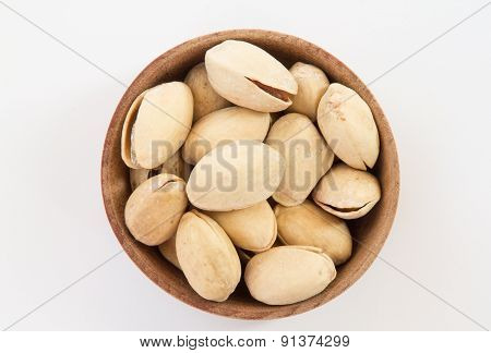 Pistachios In A Round Wooden Form