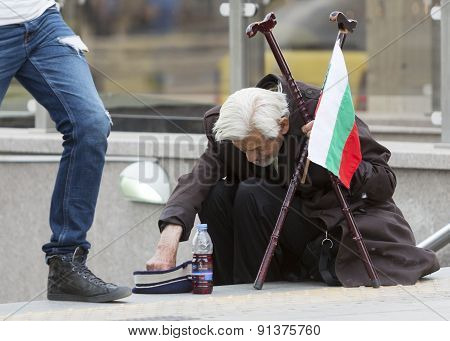 Bulgarian Beggar Taking Coins