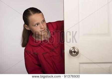 Girl behind a door