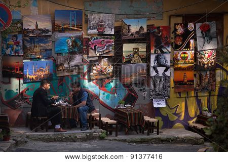 ISTANBUL, TURKEY - MAY 14 2015 : Two locals share morning tea not far from the Galata Tower