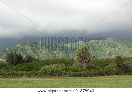 Travel To Hawaii. Mountains At The Foggy Day