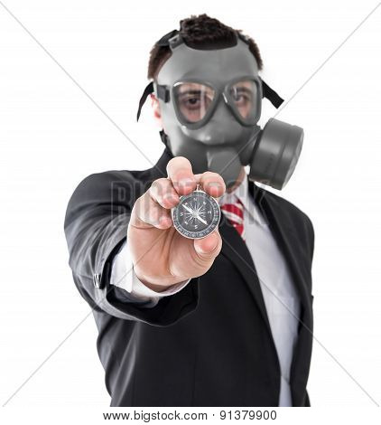Business Man With Gas Mask Holding Compass