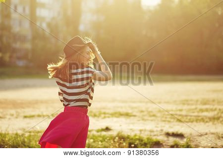 Girl In Hat And Dress For A Walk In Park.