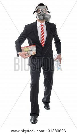 Business Man With Gas Mask Walking And Holding Food, Survive Concept