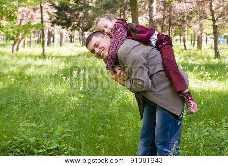Father and daughter in the park at spring