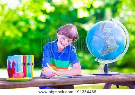 School Boy Doing Homework In School Yard