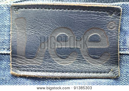Closeup of Lee label on blue jeans.
