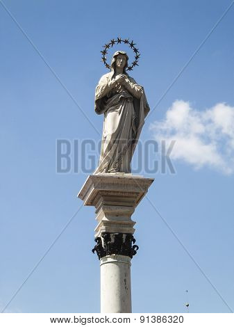 Statue Of Our Lady Of The Immaculate Conception In The Middle Of The Square In Front Of The Monaster