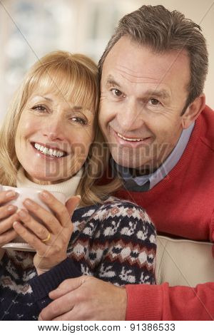 Portrait mature couple relaxing at home