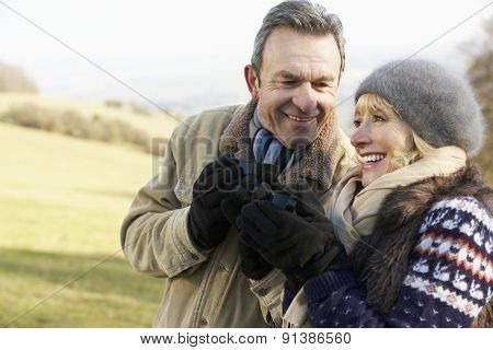 Mature couple on country picnic in winter