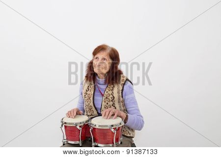 Funny Elderly Lady Playing Bongo.