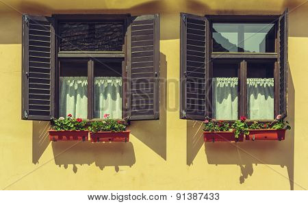 Window With Open Shutters And Flowers