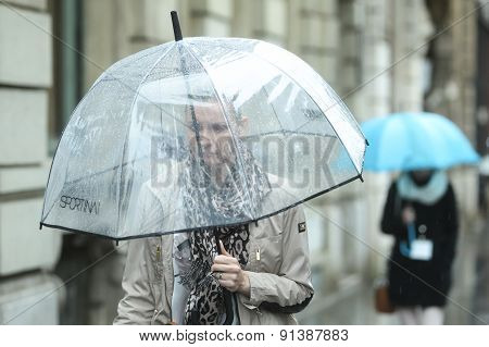 Woman With Transparent Umbrella On Street