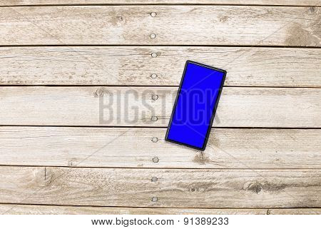 Mobile Phone On Wooden Floor