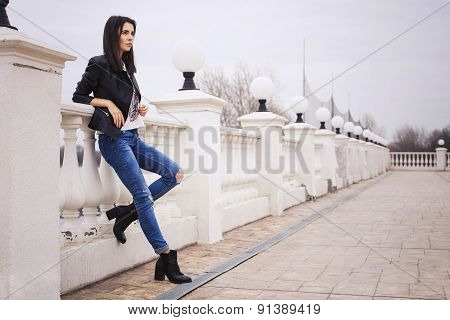 Beautiful Brunette Woman In Black Leather Jacket Walking On The European City Street