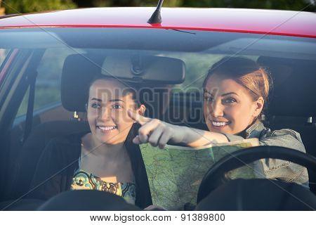 Friends In Car Enjoy Road Trip.