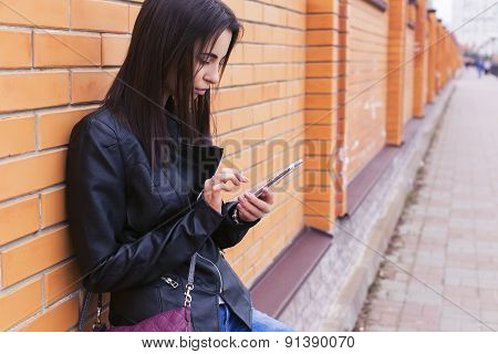 Beautiful Brunette Woman On A Walk In European City Using Her Smartphone Working. Outdoors