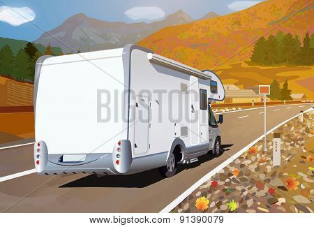 Camper traveling on mountains road at autumn season.
