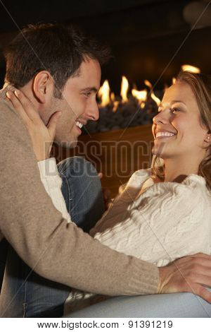 Romantic portrait couple in front of fire