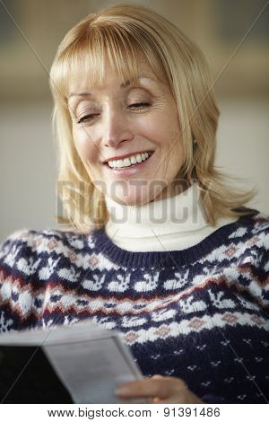 Senior woman reading at home