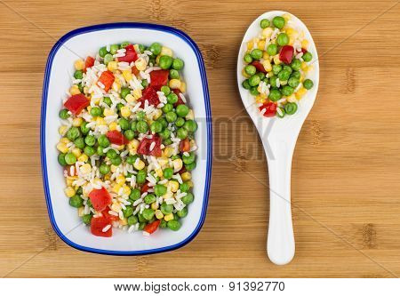 Vegetable Mix In Bowl On Wooden Board And Plastic Spoon