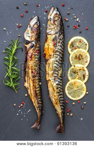 Baked Mackerel Fish With Herbs And Lemon On Stone