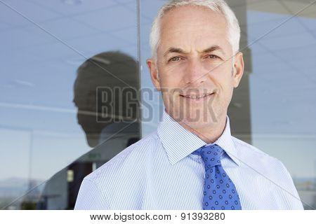 Mature Businessman Standing Outside Modern Office