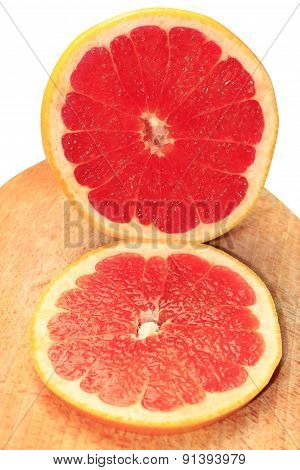 Pieces Of Grapefruit On The Board Isolated