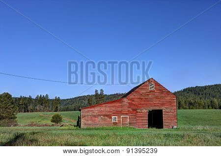 Barn In Green Field.
