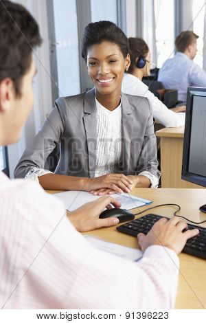New Employee Starting Work In Busy Office