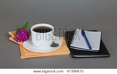 Cup of coffee with a saucer