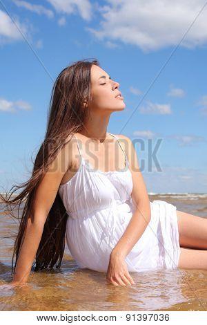 beautiful young woman relaxing on sea