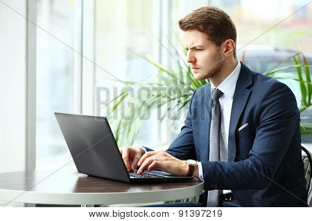 Image Of A Pensive Businessman In A Cafe