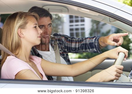 Father Teaching Teenage Daughter To Drive