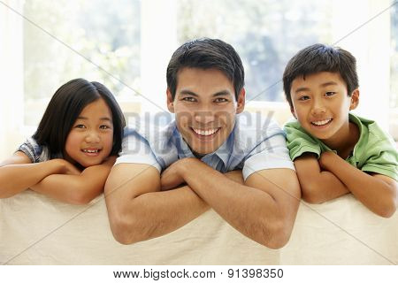 Asian father and children