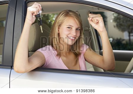 Teenage Girl Celebrating Owning First Car