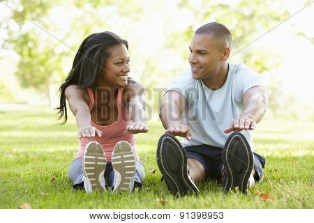 Young African American Couple Exercising In Park