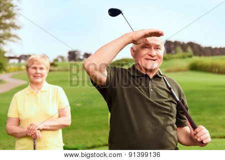Man looking into the distance on course