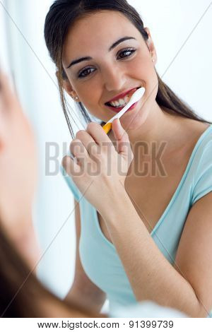 Pretty Young Woman Brushing Her Teeth.