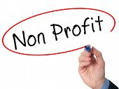 stock photo of non-profit  - Man Hand writing Non Profit with marker on virtual screen - JPG