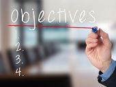 foto of objectives  - Man Hand writing Objectives to do list with marker - JPG