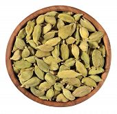 pic of cardamom  - Cardamom seeds in a wooden bowl on a white background - JPG