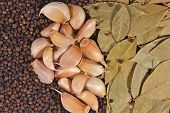 picture of peppercorns  - Top view of garlic bay leaves and peppercorns background - JPG
