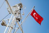 picture of mast  - Ship mast with the Turkish flag over blue sky background - JPG