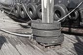 foto of barge  - A barge with a series of tires along its hull for use as bumpers when interacting with other vessels - JPG