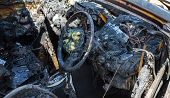 pic of scrap-iron  - Car interior after fire by fire accident - JPG